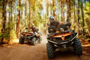 ATV riders in a forest
